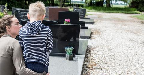 mom-and-son-graveyard-1571346303326.jpg