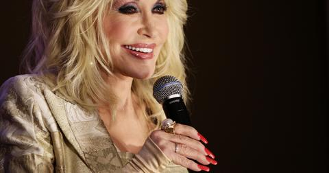 why-does-dolly-parton-wear-gloves-1573671001642.jpg