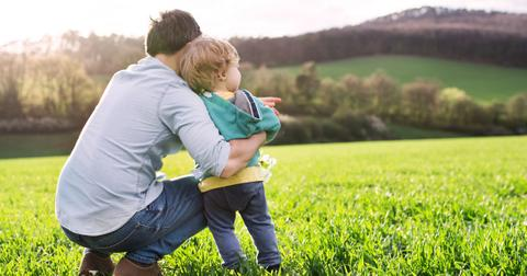 father-with-his-toddler-son-outside-in-spring-nature-copy-space-picture-id975807922-1556280874839.jpg