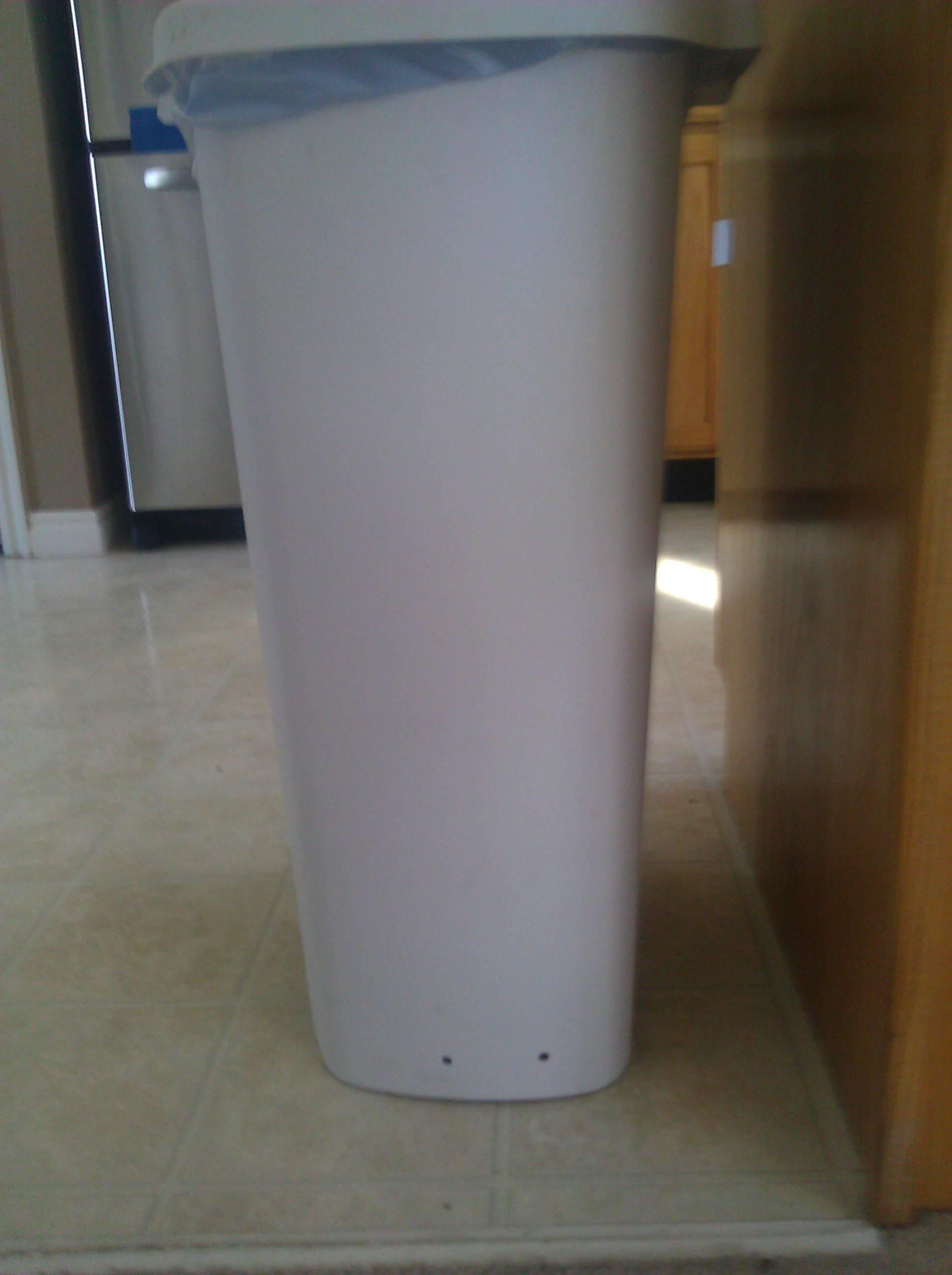 trash-can-hole-1554748994073.jpg