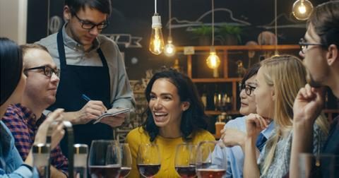 in-the-bar-restaurant-waiter-takes-order-from-a-diverse-group-of-picture-id923610794-1549920803584-1549920805244.jpg