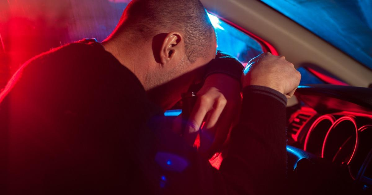 drunk-man-covering-his-face-from-police-car-light-picture-id638093310-1545067915152.jpg