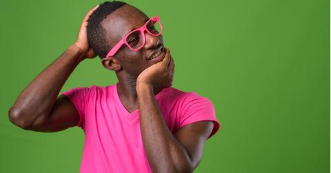 studio-shot-of-young-african-man-wearing-pink-shirt-matched-with-pink-picture-id863746504-1555349288134.jpg